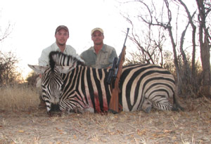 Burchelle's Zebra with Marcus and PH Paul Brits